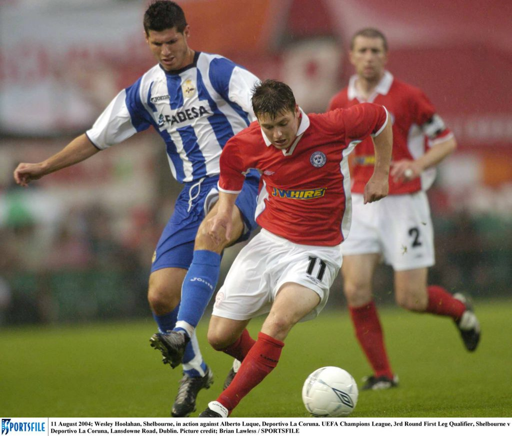 Wesley Hoolahan from Shelbourne in possession of the ball with Alberto Luque from Deportivo la coruna close behind in 2004 UEFA game