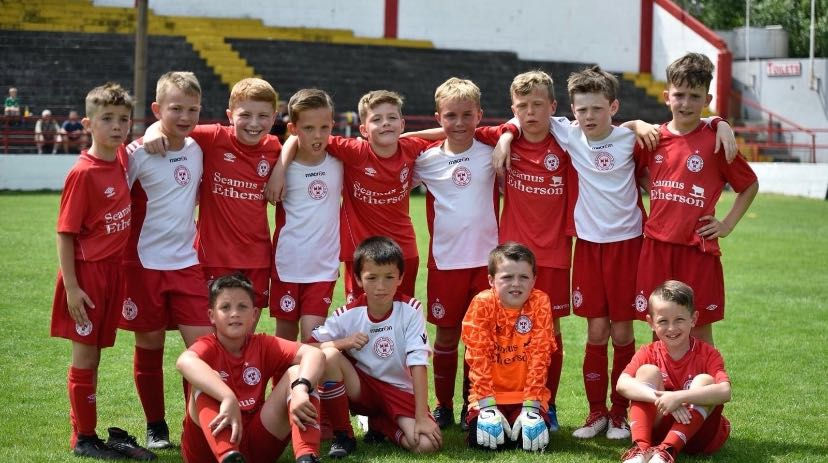 Shelbourne FC Little Reds Academy gathered on the Tolka Park football pitch
